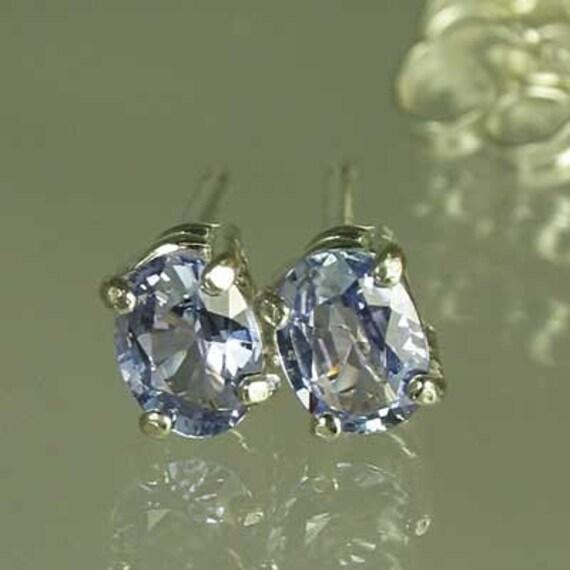 Tanzanite from Tanzania .59 carat t.w. Handset in .925 sterling silver earrings.