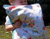 Retro Circus nursery cushion in white & turquoise