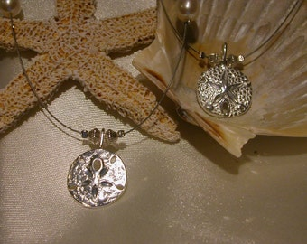 Sandy Neck Sand-Dollar Necklace.....16-18 INCH, Enjoy the Sand-Dollars, but leave them in the water.  16 in w/2in x-chain
