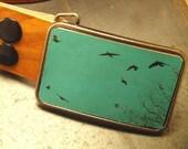 Leather Teal belt buckle. Flying birds.