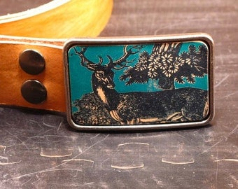 Stag belt buckle on leather