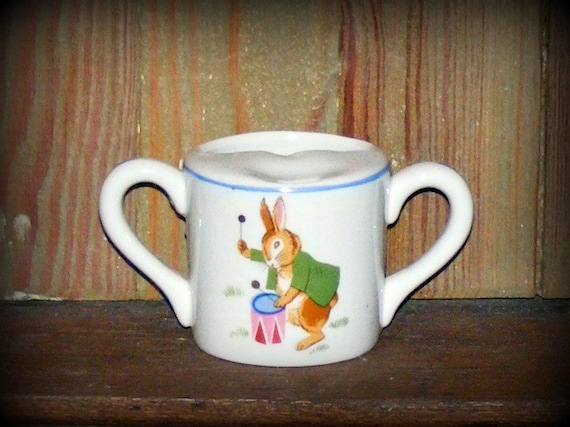 Antique Tot Trainer Porcekins by Dwight Morris Double Handle Pottery Childs Cup with Bunny playing Drum