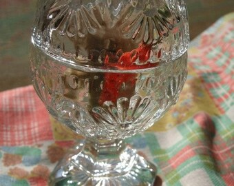 Glass egg with sea shell pattern and cover on pedestal base