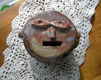 Pottery FEED ME Coin BANK with Unique Face  Artist signed
