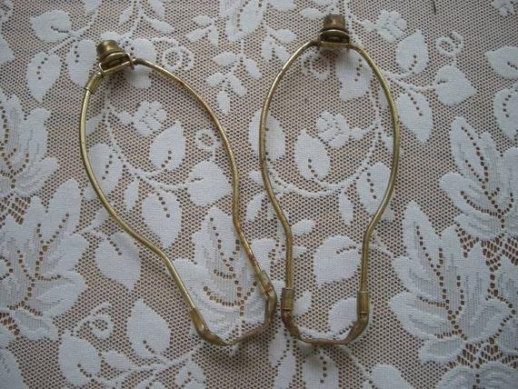 2 rusty lamp harps