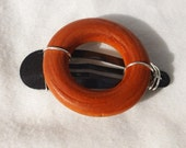 orange wood ring wire wrapped on barrette