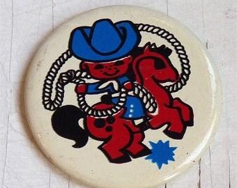 Vintage USSR pin (brooch), M Cowboy on white