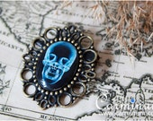 Skull x-ray brooch
