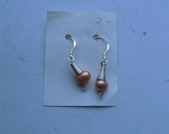 Earrings with orange freshwater pearls