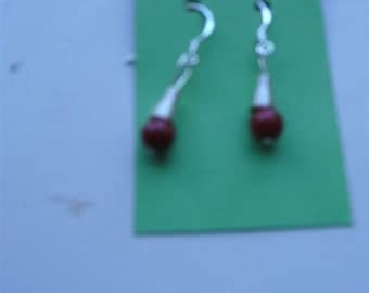 Earrings with red coral