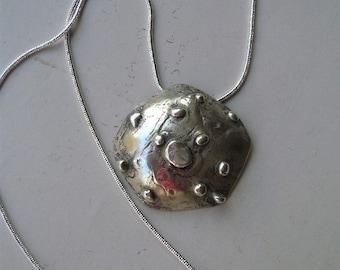 Silver urchin pendant