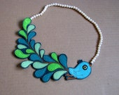 Green Bird with pearls necklace