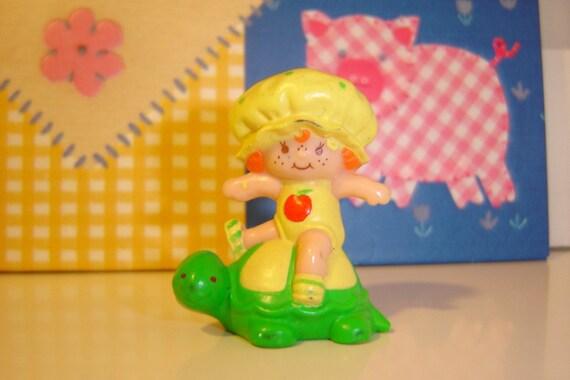 Apple Dumplin Sitting on Tea Time Turtle Miniature