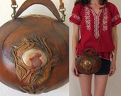 brown SCULPTED LEATHER round saddle bag