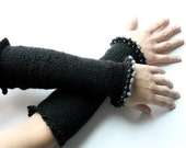 Black arm warmers with ruffled trims