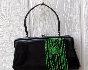 navy clutch with green tree