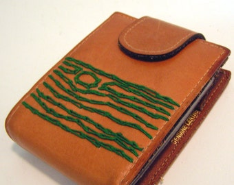 leather wallet with green tree
