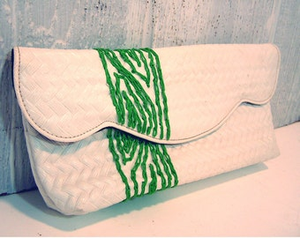 white clutch with green tree
