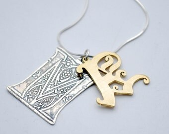 Silver and brass initial pendant