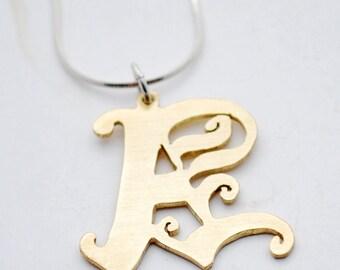Brass letter pendant