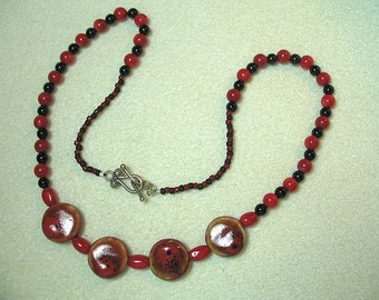 Ceramic disks with Onyx and Coral beads necklace