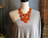 orange bib statement necklace