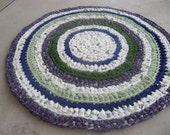 Purple, greens and cream circle crocheted rag rug (a)