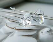hearts aflutter. Crystal Clear on Silver Teardrop Hoop Earrings