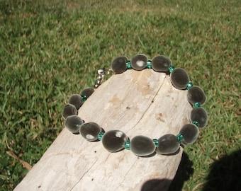 Mgambo Seeds / Hua Weleweka Bracelet with silver lined green peridot toho beads