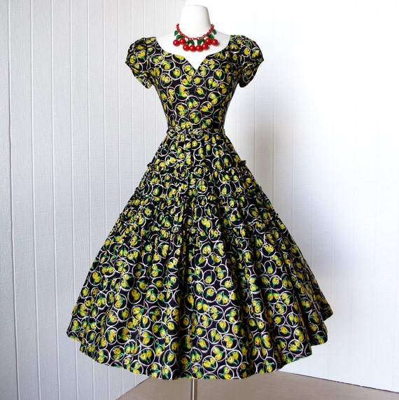 vintage 1950's dress ...fabulous JONATHAN LOGAN black and yellow rose bud novelty print full skirt pin-up party dress