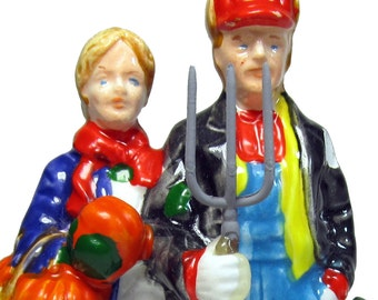 Dept 56 Ceramic Farmer Couple with Pumpkins and snow SALE