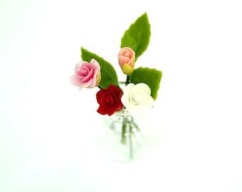 Miniature flowers, Sweet Roses, Mini Bouquet in clear glass bottle