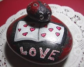 Book of Love River Rock with Lady Love Bug