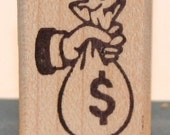 NEW Hand Holding A Big Bag Of Money Rubber Art Stamp