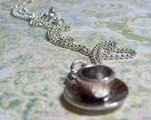 Tea for two...silver tea cup and saucer necklace.