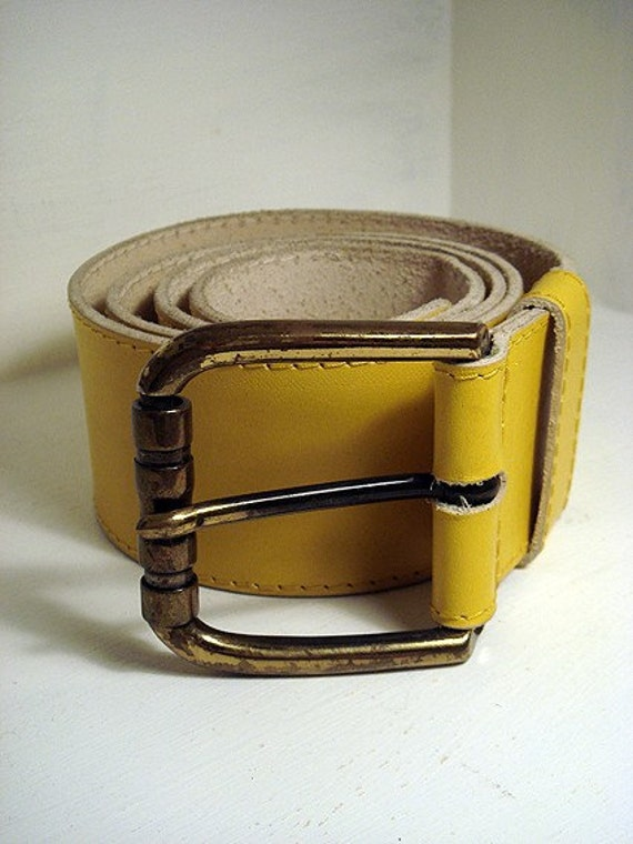vintage wide yellow belt with an antiqued golden buckle