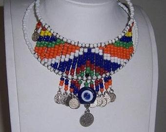 Seed bead ethnic necklace...  with evil eye,