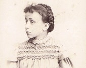 Girl with with funny expression and braided hair- Antique vintage photo Carte de visite photograph