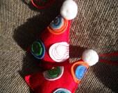 Set of handmade red felt christmas tree ornaments