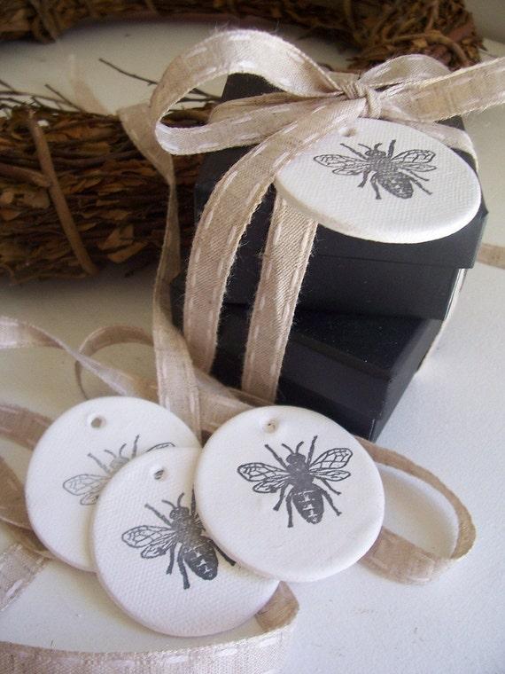 Buzz Mini Clay Tags - set of 4