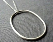 Large Oval Sterling Silver Necklace. Modern, sleek, simple design for everyday wear.