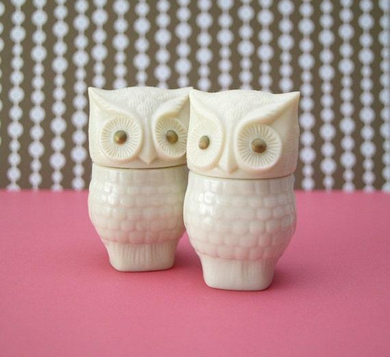 Two Avon white owls