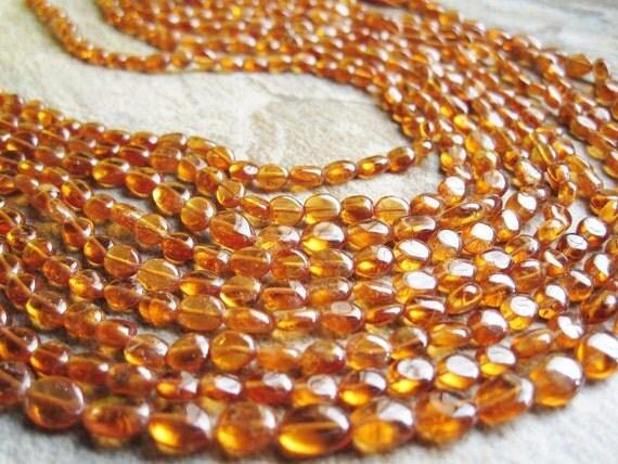 Golden Fanta Orange aka Spessartite  Garnet Smooth Oval Full strand