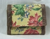 3 fold Wallet with a soft yellow back ground and  blue and red flowers