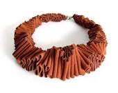 rusty orange bib necklace, avant garde ruffle fashion, urban jewelry,