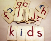 Sandpaper letters, lowercase manuscript, mounted on birch wood