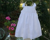 Dress with scalloped edge embroidered white eyelet bodice.     Available in larger sizes 7, 8 and 10