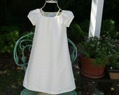 Lovely lined girls dress in ivory   embroidered eyelet ....Size 5y,6y,7y,8y & 10    Perfect for Baptism and Flower Girls..