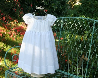 Baptism   Flower girl    White lined girls dress  Available in sizes 3 months to 10