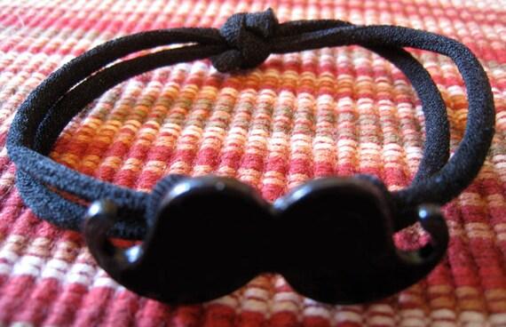Mustache stretchy bracelet.